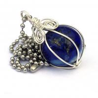 "Lapis Lazulie gemstone sphere that is wire wrapped and comes with a 24"" chain"